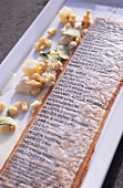 Goat's cheese snow and edible menu (molecular cuisine)
