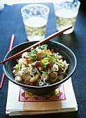 Asian noodles with pork, cashew nuts and coriander