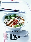 Asian noodle soup with tofu, pak choi and mushrooms