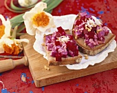 Beetroot salad with horseradish on brown bread