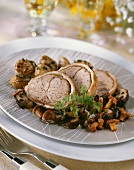 Roast veal with mixed mushrooms