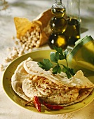 Flatbread with hummus (Chick-pea puree, Arab cuisine)