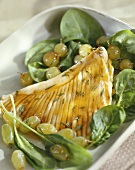 Skate wing with spinach and grape salad