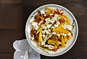 Pumpkin gratin with tomatoes and feta cheese