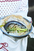 Mackerel with vegetables in baking parchment