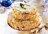 Two-tiered almond cake with carambola slices