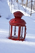A red lantern in snow