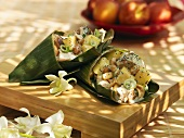 Chicken and peach salad with peanuts in banana leaf