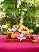 Still life with exotic fruit and orchids
