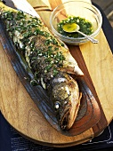 Grilled zander with lemon and herb sauce