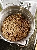 Soba noodles in a colander
