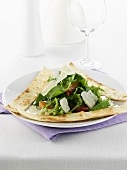 Green salad with orange segments, shaved cheese & pita bread