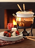 Chocolate fondue with strawberries, marshmallows & candy bars