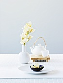 Asian bowl, white orchids and teapot