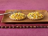 Two exotic fruit tartlets