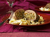 Beef with macadamia and olive stuffing and ribbon pasta