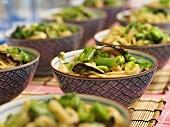Asian noodle salad in several bowls