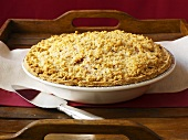 Rhubarb crumble with sour cream in pie dish