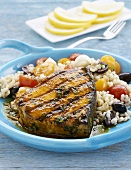 Swordfish steak with barley salad