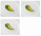 Making a design with two-coloured kiwi fruit sauce
