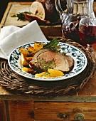 Roast lamb with herbs, orange segments & rosemary potatoes