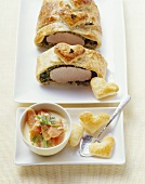 Pork fillet with herbs in puff pastry, with creamy carrots