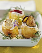 Baked potatoes with various fillings on sea salt