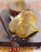 Baked banana in filo pastry with shreds of chilli