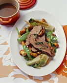 Boiled veal rump with braised romaine lettuce & chanterelles