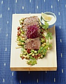 'Black and white' tuna with avocado and sprouts