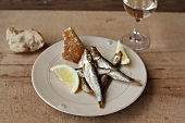 Sprats with bread and white wine