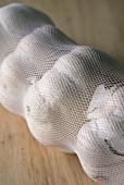 Garlic bulbs in a net (close-up)