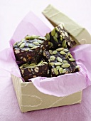 Chocolate slices with dried fruit and nuts