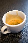 A half-full espresso cup