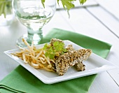 Sesame-crusted lamb with sprouts and parsley