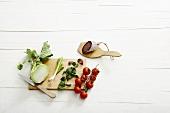 Kohlrabi, spring onions, marjoram, tomatoes and salami