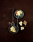 Cheese fondue with cubes of bread and fig