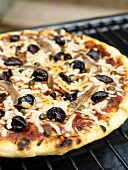 Pizza alla puttanesca (topped with anchovies, olives & capers)