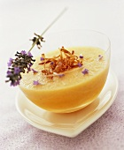 Chilled melon soup with lavender flowers