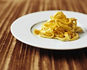Noodles with stockfish and saffron sauce