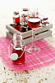 Cherry liqueur in small flip-top bottles and in glass