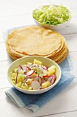 Radish and pineapple salad and pancakes