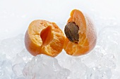 Frozen apricot halves with ice cubes