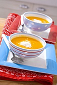 Pumpkin soup with Parmesan in two bowls