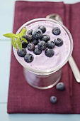 Blueberry quark with fresh berries in a glass