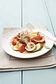 Chicken roulade on tomatoes and courgettes