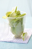 Slices of Granny Smith apples, cocktail stick in plastic tub
