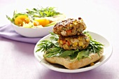 Chicken and vegetable burgers on half a bread roll