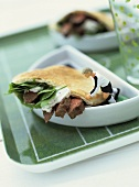 Pita bread filled with strips of steak & crème fraîche sauce