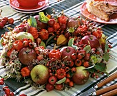 Wreath of apples, rose hips and Chinese lanterns